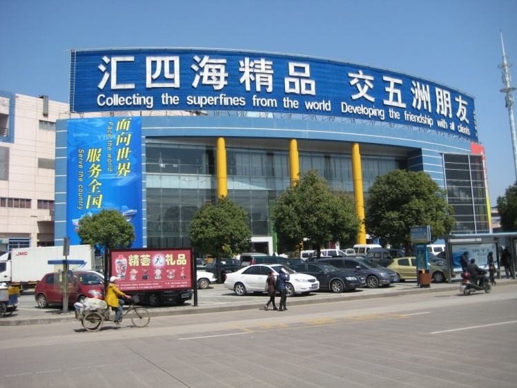 Which train station from shanghai go to yiwu , futian market