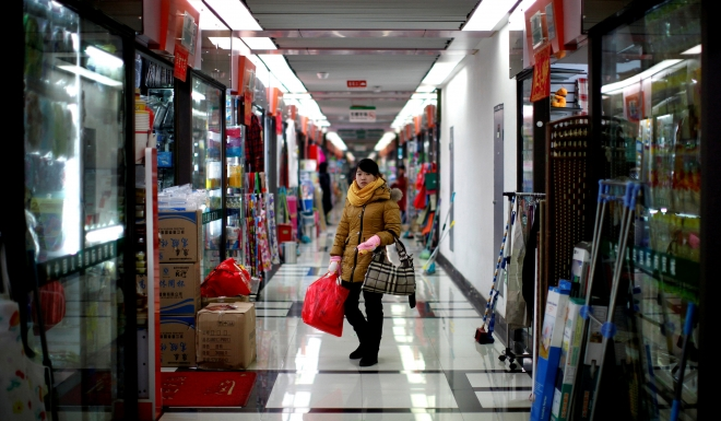 A woman shops in the wholesale market in Yiwu.